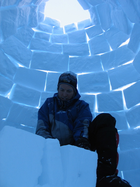 Finishing up an igloo on a down day on Denali